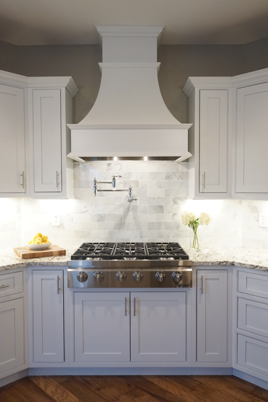 White frontenac kitchen affordable kitchens and baths for Shaker style kitchen hoods